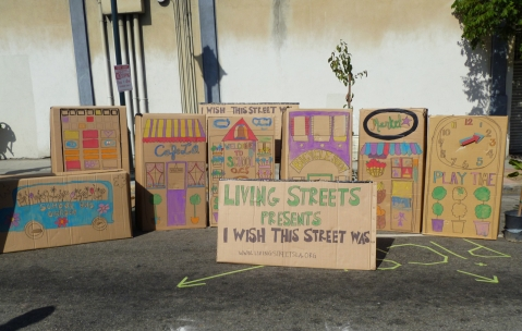 "Cardboard storefront facades painted by participants of ""I Wish This Street Was..."" presented by Living Streets Los Angeles at CicLAvia. Photo by Living Streets Los Angeles"