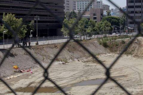 Sunbathers in an empty pit in Downtown Los Angeles by Calder Greenwood. Photo by Calder Greenwood via KCET Departures.