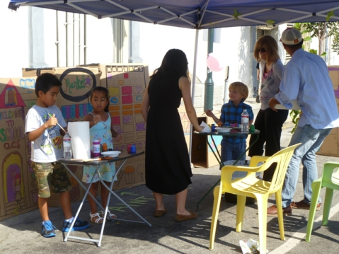 "Children painting with their parents for ""I Wish This Street Was..."" presented by Living Streets Los Angeles at CicLAvia. Photo by Living Streets Los Angeles"