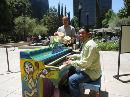 Musicians having fun at a street piano in Los Angeles. Photo by Elson Trinidad via streetpianos.com