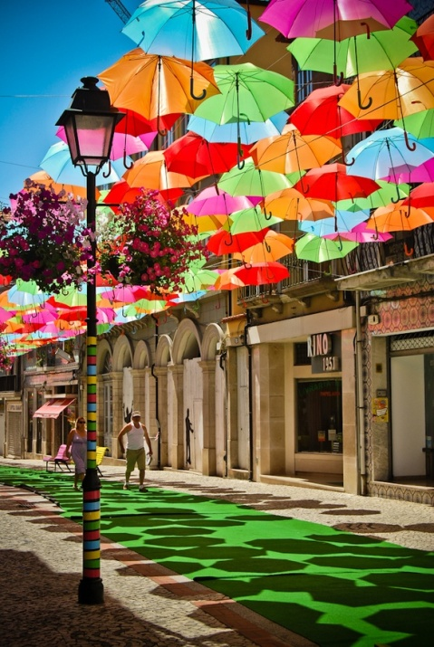 A colorful canopy of umbrellas, a part of the Agitagueda art festival in Águeda, Portugal. Photo by Patrícia Almeida