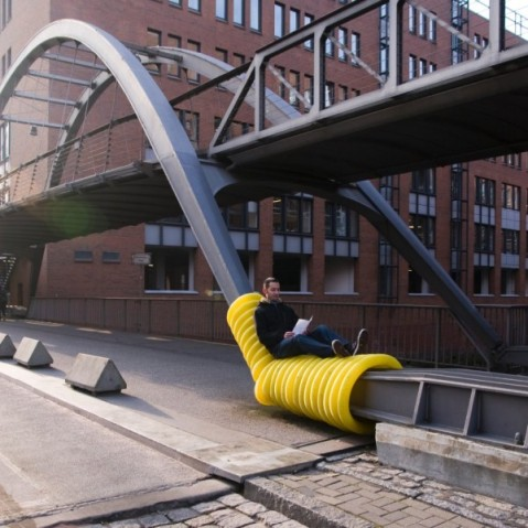 "Oliver Show's ""Street Furniture"" series wraps yellow drainage pipes around public infrastructure in Hamburg, Germany"
