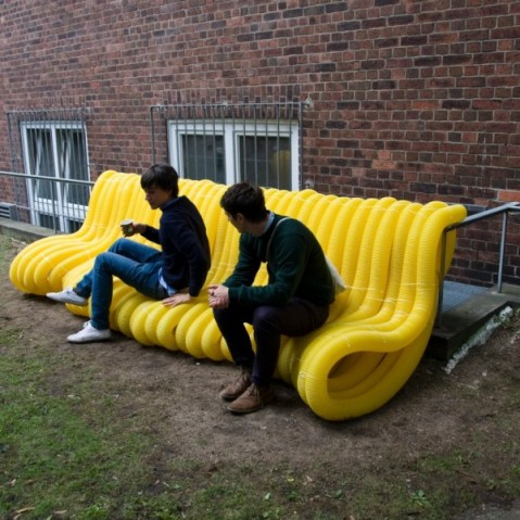 "Oliver Show's ""Street Furniture"" series wraps yellow drainage pipes around public infrastructure in Hamburg, Germany. Photo by Der Spiegel via Architizer"
