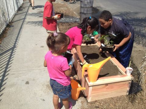 The 58th Street Dig-In (2013). Photo by St. John's Community Health Center via Streetsblog LA